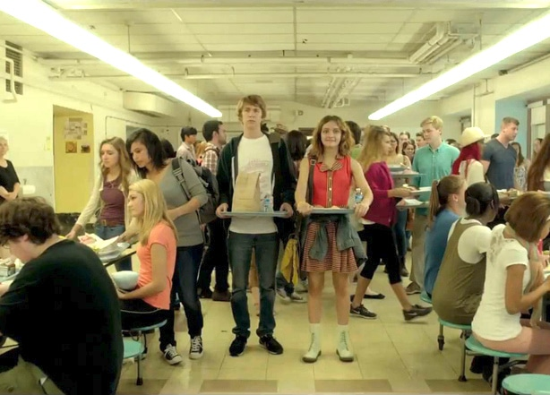 High school characters in Me and Earl and the Dying Girl stand in a crowded lunch room